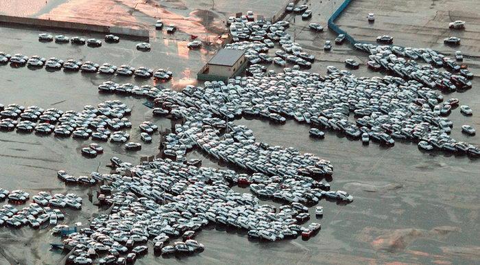 Новые автомобили, готовые к отправке, в городе Хитачинака (STR/AFP/Getty Images).